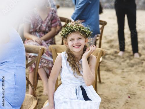 Obraz na płótnie Little bridesmaid at a beach wedding