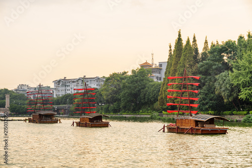 Foto op Canvas Guilin Wooden ships decorated with red flags in Guilin, China