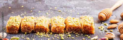 Photo Homemade baklava with nuts and honey.