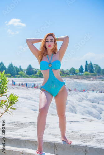 8a9709bec5 Natural pretty young woman in swimsuit near the sea. Size plus and xl women.  Swimsuit bikini ,lady at beach