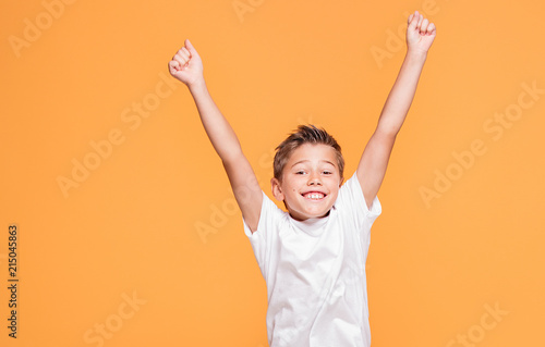 Fotografie, Obraz  Little boy jumping in the studio, smiling.