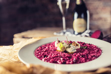 Plate Of Tasty Beetroot Risotto With Cheese And Aperitif
