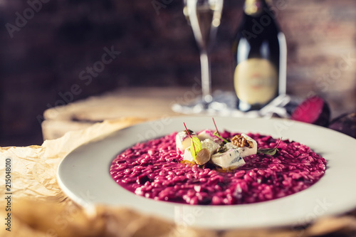Canvas Plate of tasty beetroot risotto with cheese and aperitif