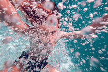 Swimming Kid Surrounded Air Bubbles