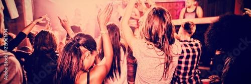 People enjoying in nightclub Fototapeta