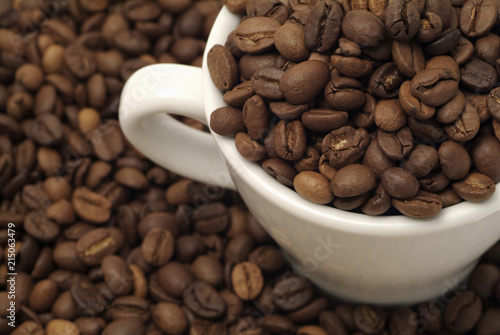 Top view of a cup filled with coffee beans