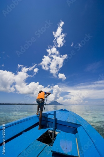 Ship Boy Hauling In The Anchor Siladen National Park Sulawesi Indonesia Southeast Asia