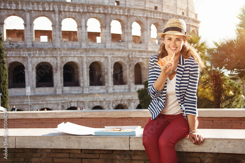 Fotografia, Obraz  happy modern tourist woman in Rome, Italy eating pizza