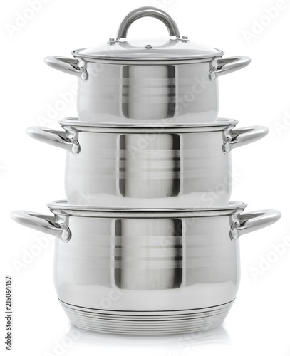 Set of three metal pans, stack of pans on a white background
