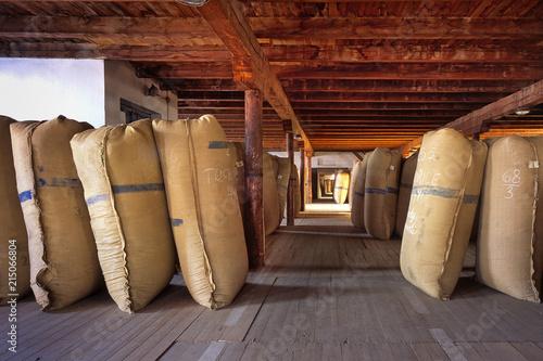 Fotografie, Obraz  ZATEC TOWN,  CZECH REPUBLIC - August 25, 2017: Sacks of hops in historical storehouse in Zatec town