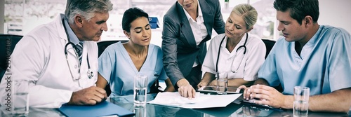 Obraz Team of doctors and businesswoman having a meeting - fototapety do salonu