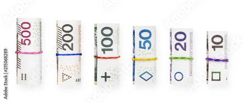 Fotomural  Rolled with a rubber polish zloty banknotes isolated on white background with cl