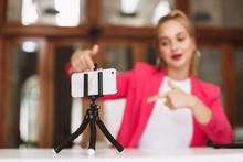 Close Up Young Female Blogger Recording New Video On Smartphone Isolated