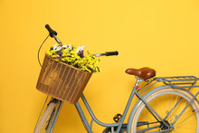 Retro Bicycle With Wicker Basket On Color Background