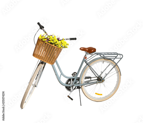 Retro bicycle with wicker basket on white background