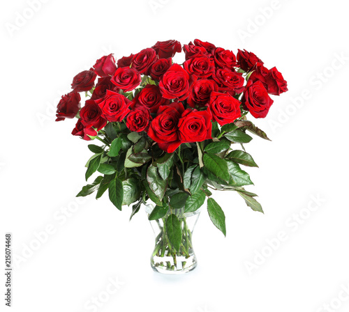 Vase with beautiful red roses on white background