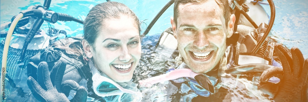 Fototapeta Portrait of smiling couple on scuba gears