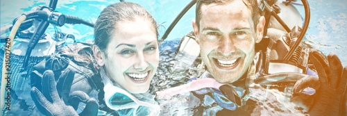 Fototapeta Portrait of smiling couple on scuba gears obraz