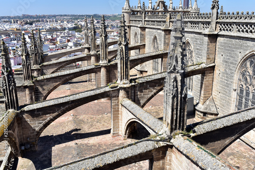 Fényképezés Flying buttresses on the roof of Santa Maria de la Sede Cathedral, Seville, Spai