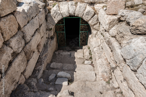 Spoed Foto op Canvas Oude gebouw Gate of Aya Tekla underground cave Church also known as Saint Aya Thecla or Aya Thekla, is ruined historic church of Byzantine period pilgrimage site located in Silifke,Mersin,Turkey.