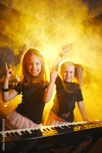 Printed kitchen splashbacks Fairytale World little girl play on synthesizer in music studio