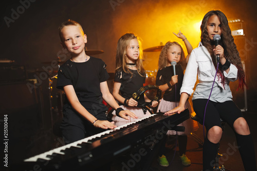 Fototapeta children singing and playing music in recording studio obraz na płótnie
