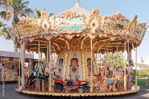 Fotografie, Obraz  Old carousel - Cavalaire sur Mer - France