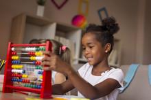 Girls Using Abacus