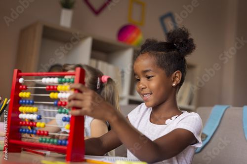 Girls using abacus Canvas Print