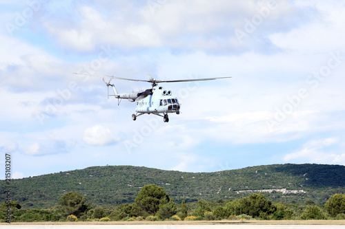 Tuinposter Helicopter Military helicopter in action