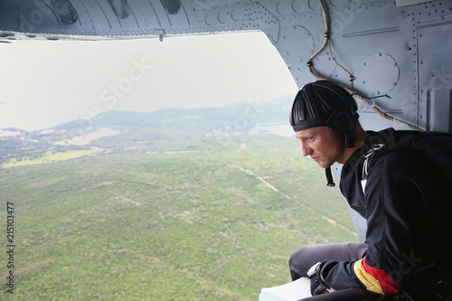 Skydiver ready to jump from helicopter, Losinj Island, Croatia