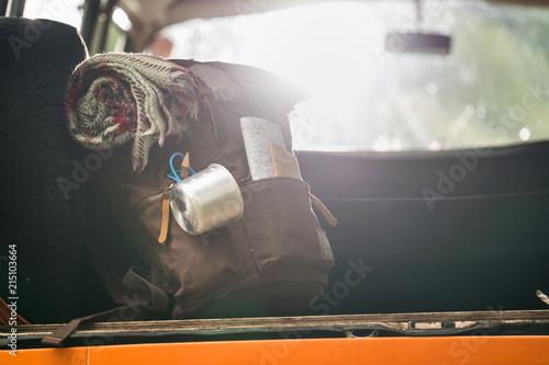 Fotografia  Backpack inside a truck, ready for hiking