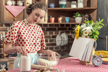 Attractive Adult Housewife Kneading Dough In Bowl At Kitchen