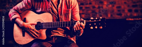 Obraz Young man playing guitar  - fototapety do salonu