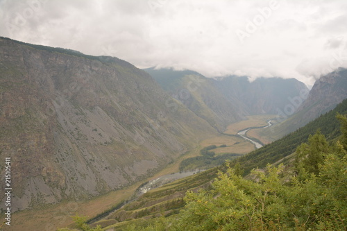Deurstickers Asia land nature landscape landscape mountains valley hills rocks cave water waterfall stream river stream rock stone sky grass trees green blue white tourism excursions Russia