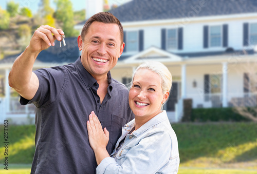 Fotografie, Obraz  Young Adult Couple With House Keys In Front of Beautiful Home