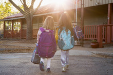 Two Sisters Outside Their School Before Classes Begin.