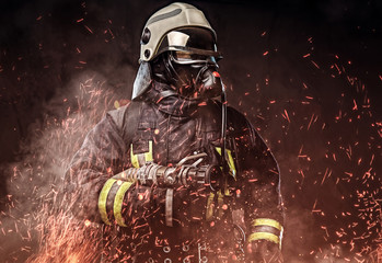 A firefighter dressed in a ...