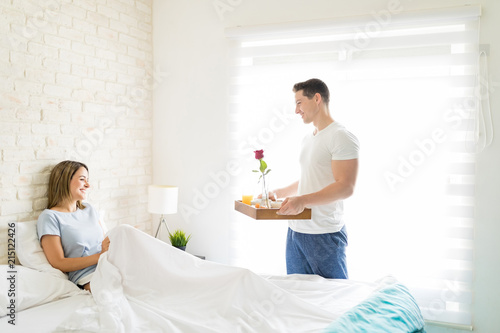 Boyfriend Bringing Tray With Breakfast For Woman In Bed Poster