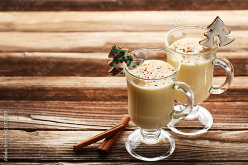 Staande foto Cocktail Eggnog in glasses with cinnamon on wooden table