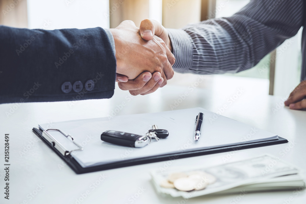 Fototapeta Handshake of cooperation customer and salesman after agreement, successful car loan contract buying or selling new vehicle