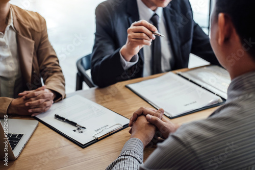 Fotografia  Two senior manager reading a resume during a job interview, Employer interviewin