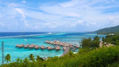 Egypt Beautiful overwater villas in stunning lagoon overlooking tropical sunny island.