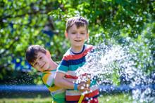 Brothers Having Fun Splash Eac...