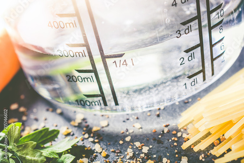 Poster  250 ml - ccm Water In A Measuring Cup Surrounded By Noodles, Herbs And Spices