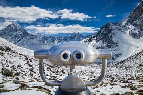 Fototapeta  Public binoculars in front of a view over mountain peaks in the Everest Region, Nepal (montage)