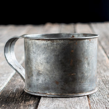 Isolated Tin Cup On Weathered ...