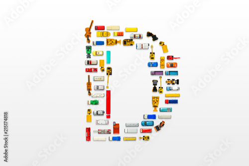 Photo  English letters formed by arrangement of Car toy diecast on the white background