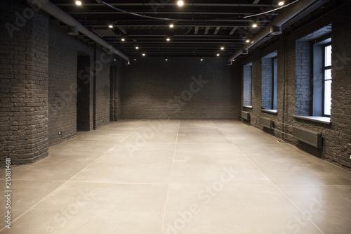 Foto op Canvas Stadion Empty room of black brick