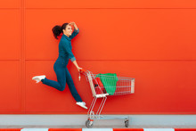 Happy Woman With Shopping Jump...